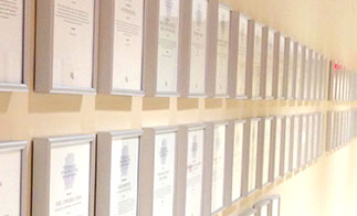 Framed documents on wall