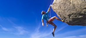 Image of rock climber to represent taking risk